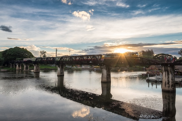Ancient train running on bridge in river kwai landmark of kanchanaburi, thailand