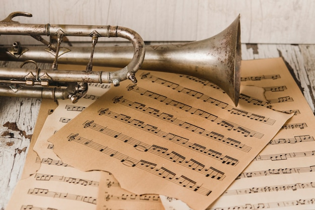 Ancient trumpet on sheet music