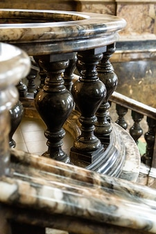 Ancient vintage marmoreal marble stairs with balusters in daylight