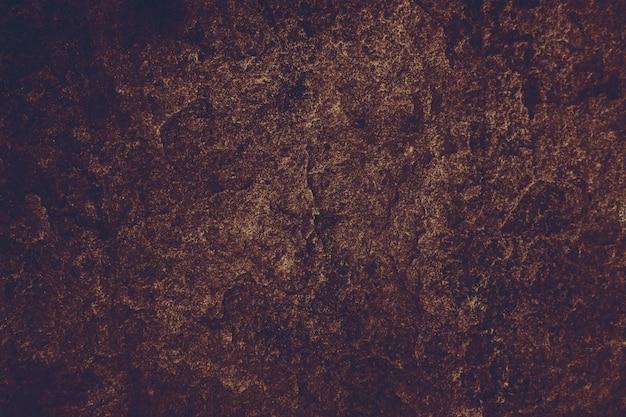 内部の洞窟の古代紫紫花崗岩石の表面