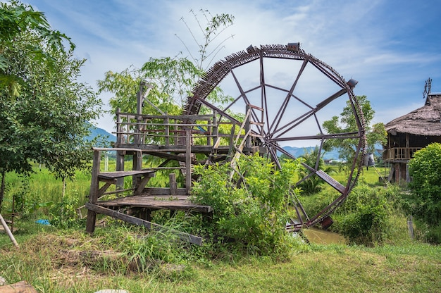 Ancient water turbine in tai dam cultural village & museum chiang khan loei thailand.chiang khan is an old town and a very popular destination for thai tourists
