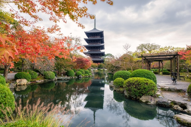 Ancient wood pagoda in toji temple of unesco world heritage site in autumn garden at kyoto