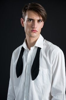 Androgynous man in shirt and tie