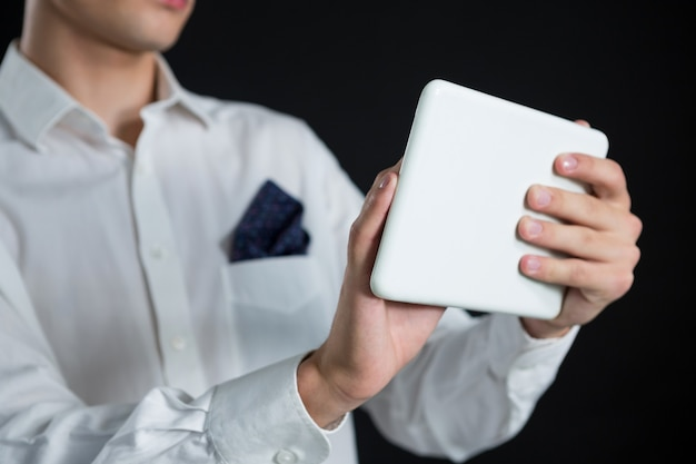 Androgynous man using digital tablet