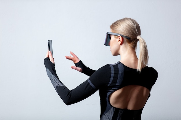 Android female in vr glasses and mobile phone on white background.