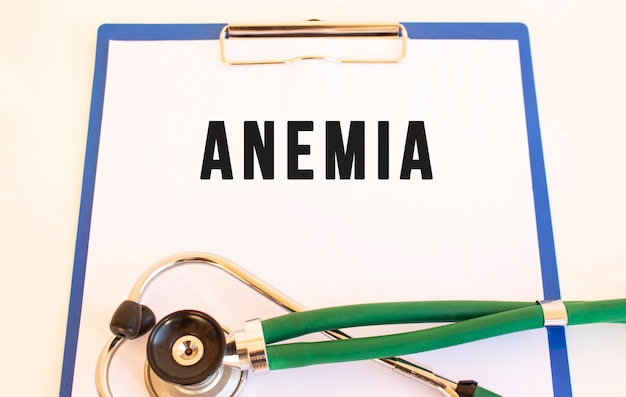 Anemia- text on medical folder with documents and stethoscope
