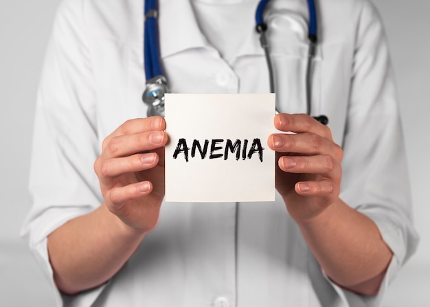 Anemia word on paper in doctor hand