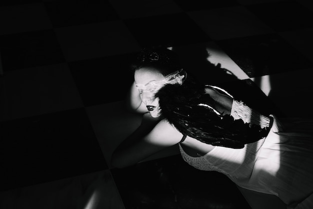 Angel in dark room