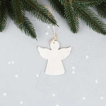 Angel ornament with fir branch