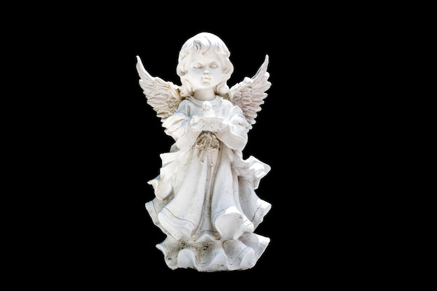 Angel statuette isolated on a black background. high quality photo