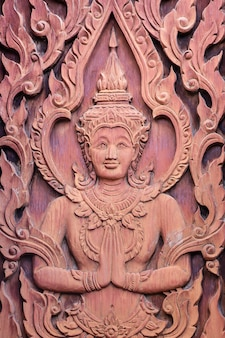 Angel in traditional thai style wood carving