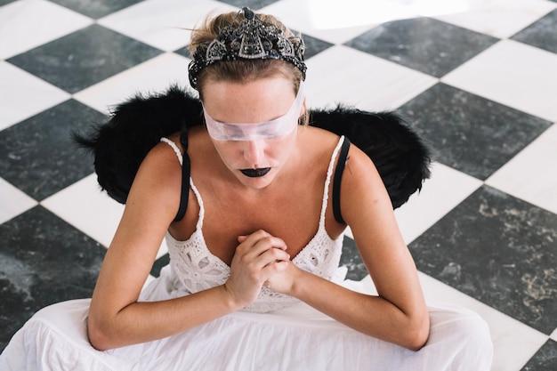 Angel in transparent eye bondage
