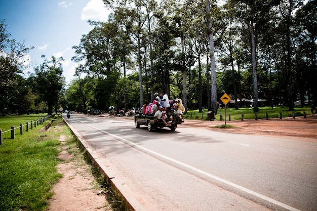 Angkor wat, cambodia - 29 october 2011:pickup truck loaded with people going to work in cambodia