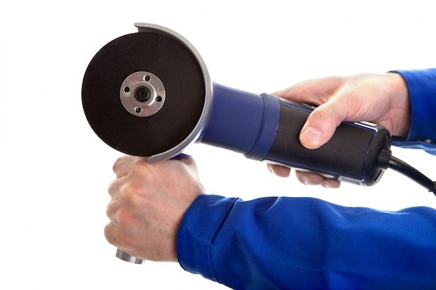Angle grinder in hands
