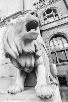 Angle shot fo stone lion near city hall in hanover, germany