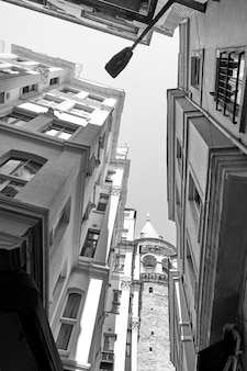 Angle shot of old street in istanbul near the galata tower, turkey. black and white image