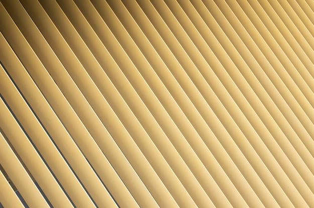 ベージュまたは金色の3dストライプの視野角。パターンのようなルーバーシャッター。