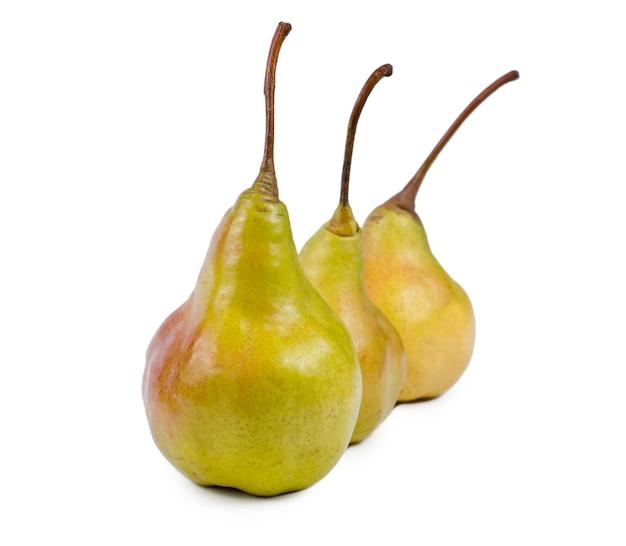 Angled receding row of three fresh ripe yellow pears