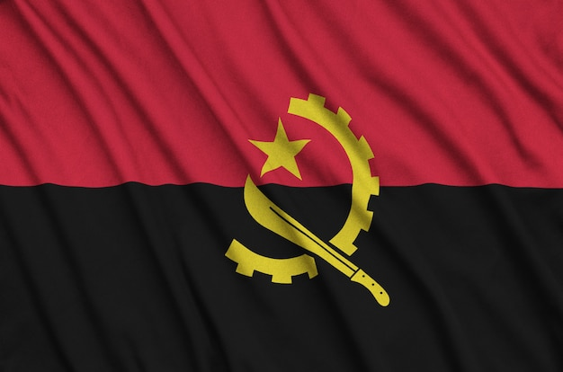 Angola flag is depicted on a sports cloth fabric with many folds.