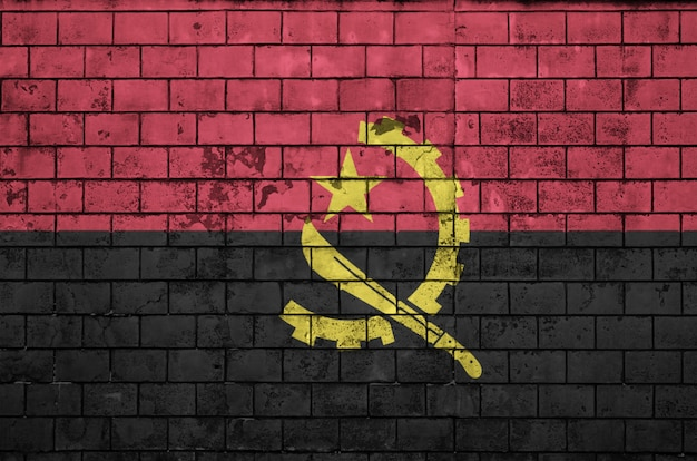 Angola flag is painted onto an old brick wall