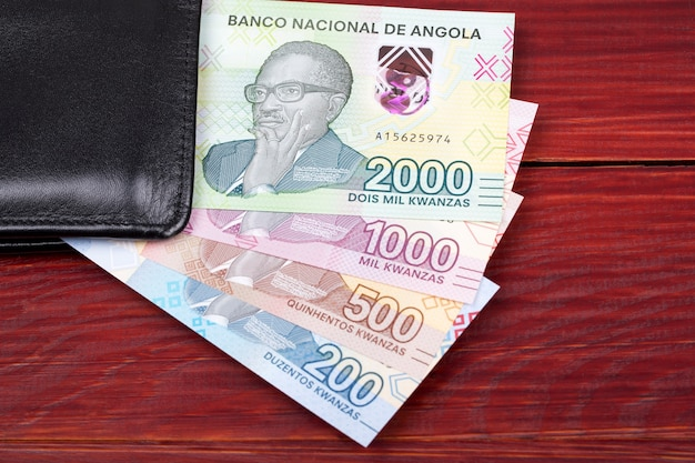 Angolan money banknotes in the black wallet