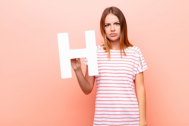Angry, anger, disagreement, holding the letter h of the alphabet to form a word or a sentence.