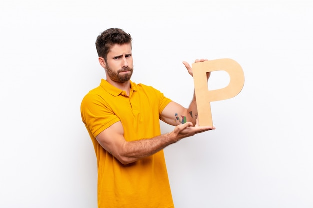 Angry, anger, disagreement, holding the letter p of the alphabet to form a word or a sentence.