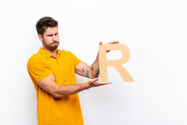 Angry, anger, disagreement, holding the letter r of the alphabet to form a word or a sentence.