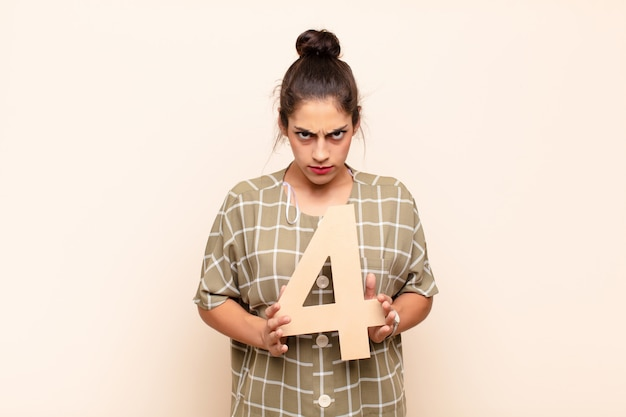 Angry, anger, disagreement, holding a number 4.