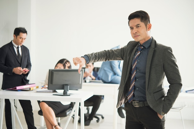 Angry boss complaining staff in office