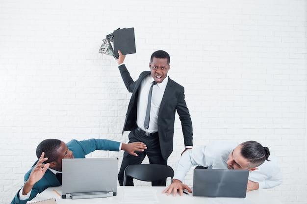 Angry boss firing teamwork