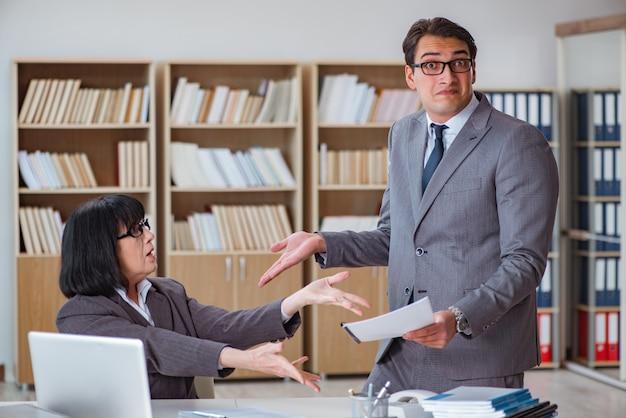 Angry boss reprimanding fellow employee