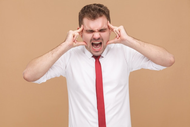 Angry businessman have migraine and headache