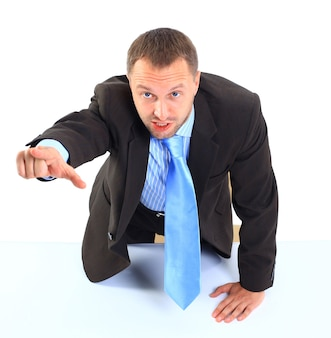 Angry businessman shouting and pointing on you