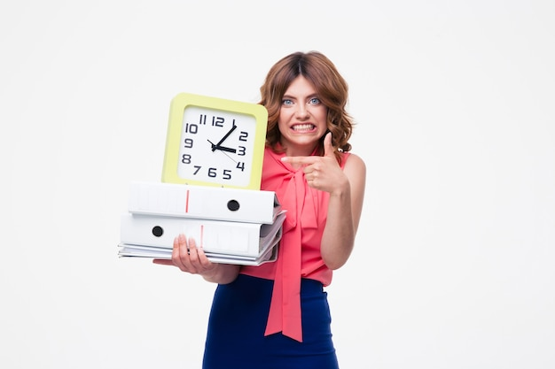 Angry businesswoman holding clock and folders