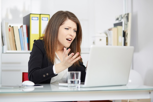 Angry businesswoman in office