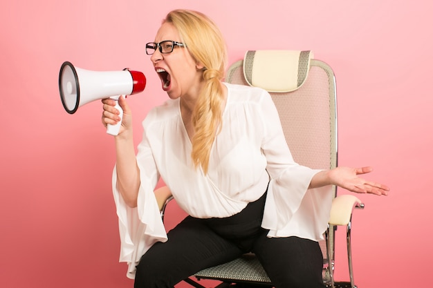 Angry businesswoman with loudspeaker