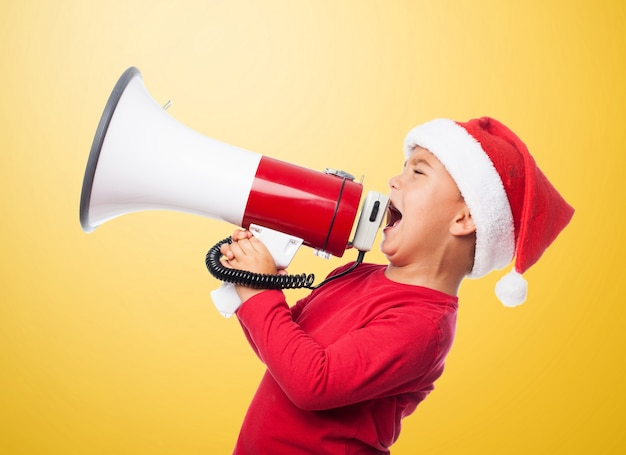 Angry child shouting with a megaphone