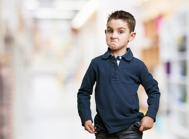 Angry child with blurred background Free Photo