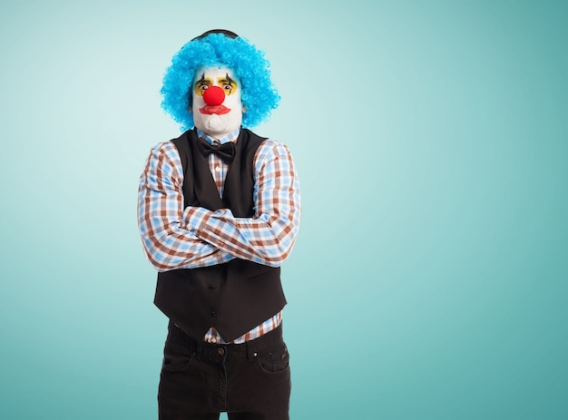 Angry clown with crossed arms