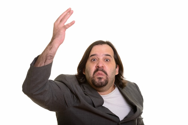 Angry fat caucasian businessman raising arm isolated on white