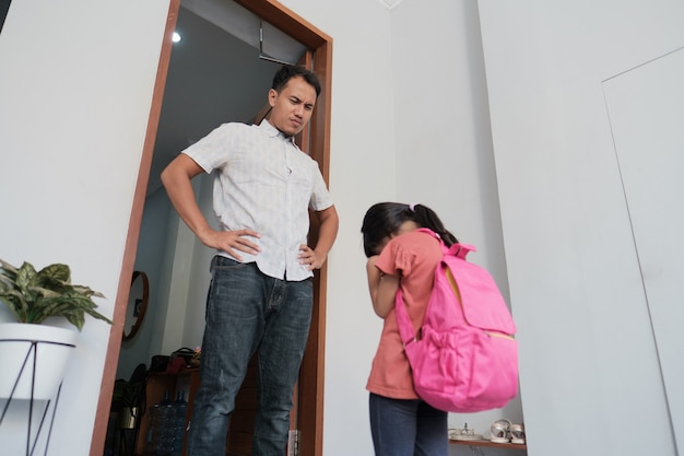 Angry father confront his kid after school. asian primary student problem. abusive parent with daughter