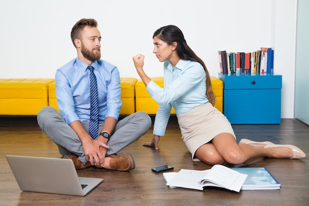 Angry gesture showing multiethnic colleague