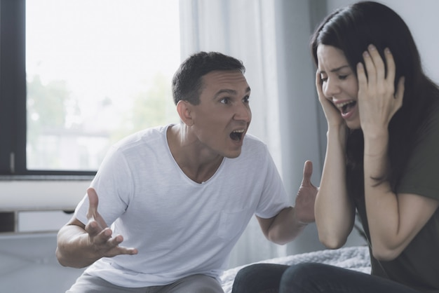 Angry husband screams at wife during quarrel