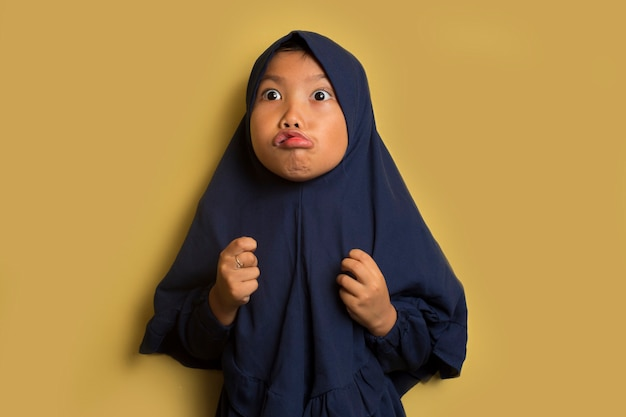 Angry little cute asian muslim hijab girl