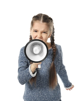 Angry little girl shouting into megaphone on white