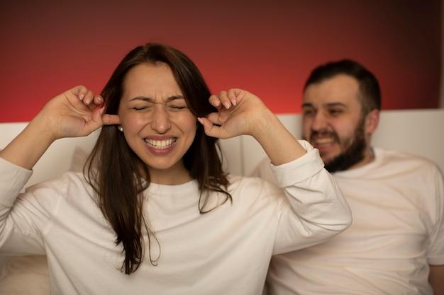 Angry man husband yells at wife during quarrel at home