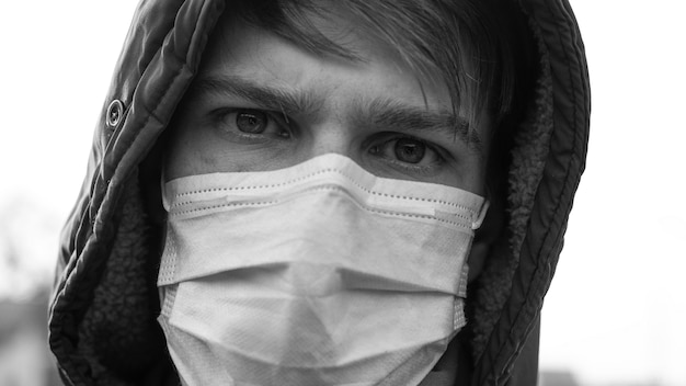 Angry man in medical mask portrait,depression in a pandemic coronavirus...