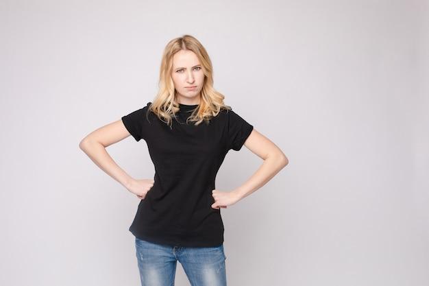 Angry or sad girl with folded arms.