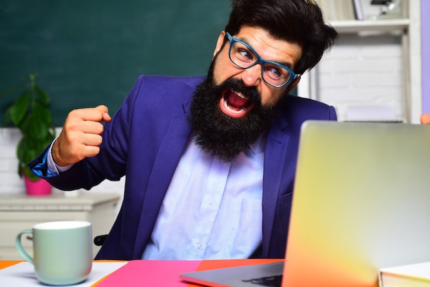 Angry scientist with laptop bearded man with notebook college teacher screaming on students stressed